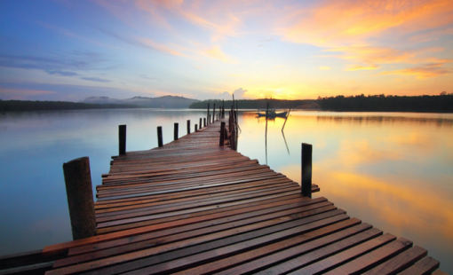 brown-wooden-dock-on-calm-body-of-water